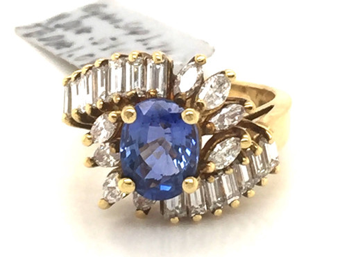 18kyg 1.79 ct oval Sapphire MQ and TB ring