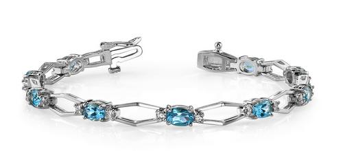 Oval gemstone, round diamond and gold link bracelet