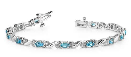 Oval gemstone, diamond and S shaped link bracelet