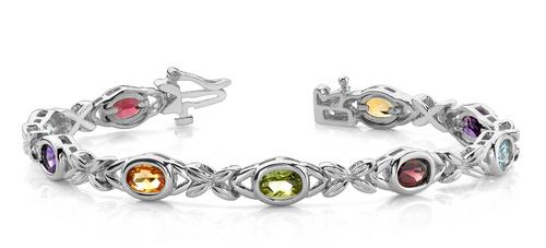 Oval gemstone and fancy link bracelet