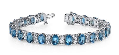 Oval gemstone 2 round diamond bracelet