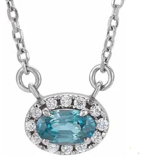"14kwg blue zircon/diamond halo necklace 18"" chain"