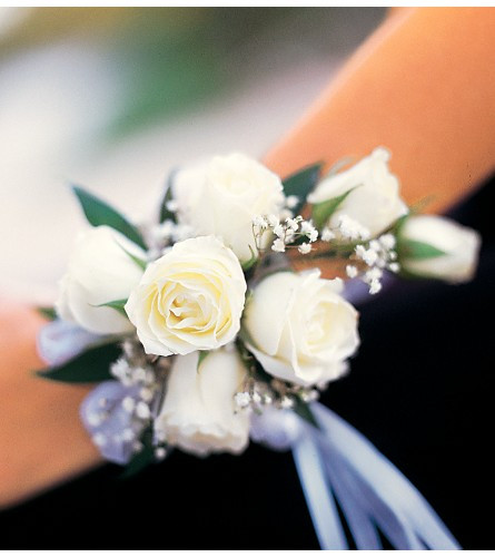 """The wristlet is created with white miniature spray roses, your choice of ribbon collor, baby''s breath and a bit of Italian ruscus. Approximately 4-1/2"""" W x 7"""" H"""