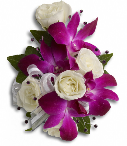 "A fantastic contrast of purple dendrobium orchids with white spray roses on a snap wristlet. Approximately 5"" W x 6 1/4"" H"