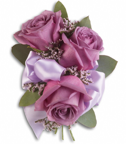 "Lavender roses, pink limonium and seeded eucalyptus on a snap bracelet Coordinating ribbons. Approximately 5"" W x 7"" H"