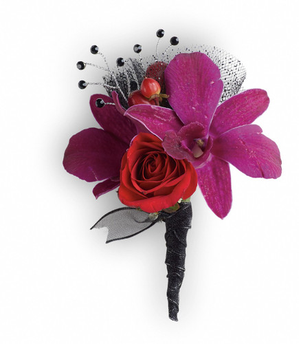 "Purple dendrobium orchids, red spray roses and red hypericum with black rhinestone accents. Approximately 2 1/2"" W x 4"" H"