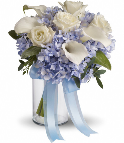 "Blue hydrangea, white callas and roses. Available in other colors  Approximately 10"" W x 11"" H"