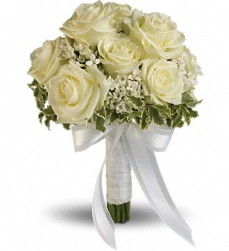 "White roses and bouvardia contrasted by variegated pittosporum. Approximately 9"" W x 11 1/2"" H"