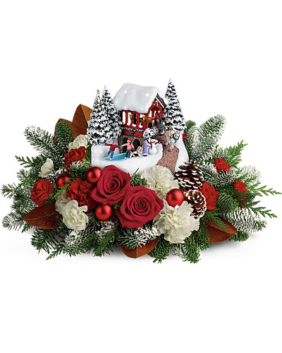 Set atop a magnificent bouquet of festive flowers and fresh Christmas greens, this light-up, hand-painted Thomas Kinkade collectible will brighten your holidays for years to come! This lush bouquet includes red roses, white carnations, red miniature carnations, and white miniature carnations, accented with flat cedar, magnolia leaves, and noble fir. Delivered with Thomas Kinkade's Snowfall Dreams keepsake. Orientation: All-Around