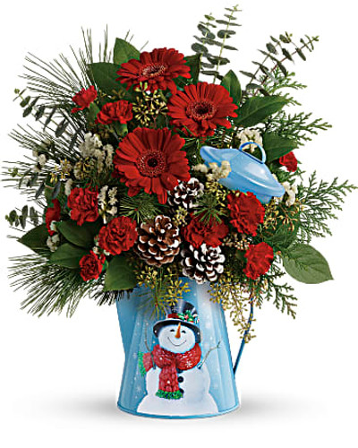 With its jolly snowman motif and vintage feel, this delightful metal kettle adds Christmas charm to a classic red and green bouquet! Red gerbera daisies, red miniature carnations, and white sinuata statice are accented with seeded eucalyptus, spiral eucalyptus, flat cedar, douglas fir, white pine, and lemon leaf. Delivered in Snowy Daydreams kettle. Orientation: One-Sided