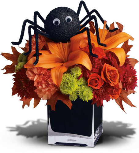 Perhaps this is the perfect WEB bouquet. Perched atop a beautiful array of fall flowers, the only place this sweet spider will crawl is right into someone's heart.