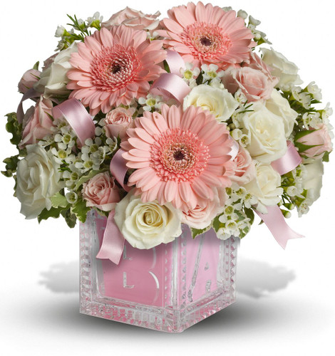 She'll be building block castles soon enough! For now, celebrate her life with this beautiful keepsake baby block. Filled with soft pinks and whites, the glass block can be used later in baby's room and makes a memorable baby girl present. A light pink ribbon weaves through white and pink spray roses in a keepsake glass Baby Block vase. Orientation: One-Sided