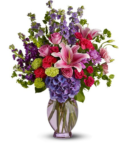 This abundant and colorful bouquet is like a stroll through a garden in full bloom. Bursting with two feet of fresh pink lilies, hydrangea and pink roses that is sure to brighten anyone's day.