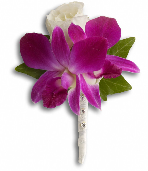 """Purple dendrobium orchids with a white rose and ivy. Approximately 3 1/2"""" W x 4 3/4"""" H"""