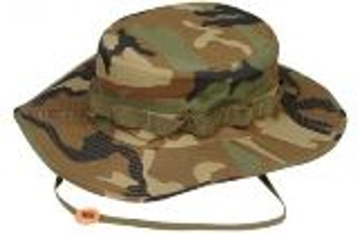 "The Boonie Hat, first used in the jungles of Vietnam, has: a 360 degree 2 1/2"" wide sun brim; stitched loops directly above the brim for adding camouflage; a drawstring chin strap; and four air vents for heat and moisture release. Made from poly/cotton blend."