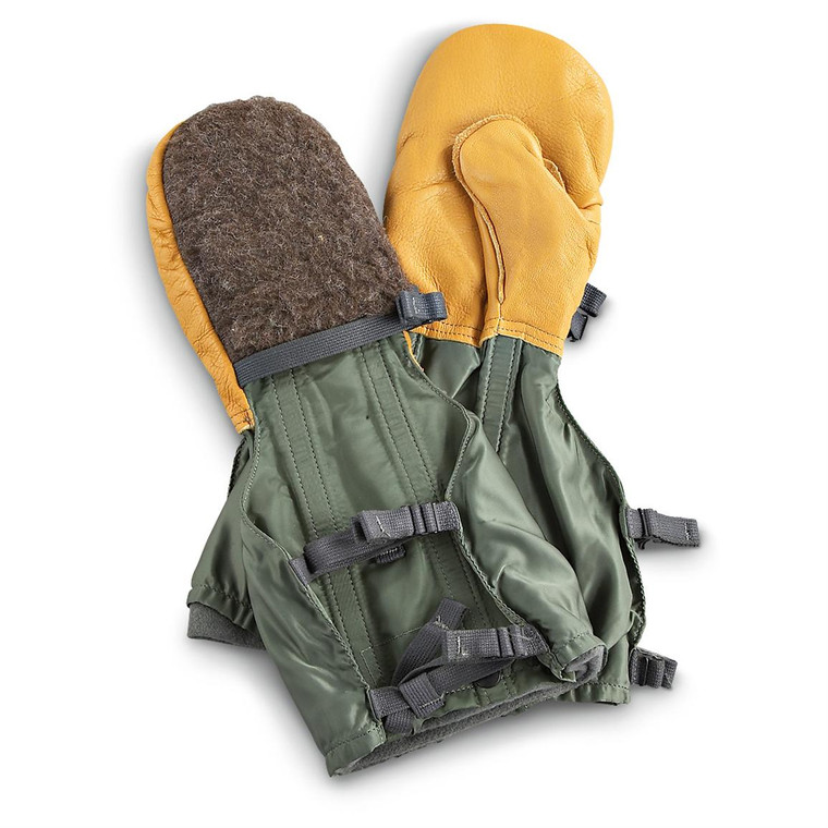 Leather palm Fur back Extended length nylon gaiter locks out cold, snow Adjustable cinch straps Comes with full-length liner.