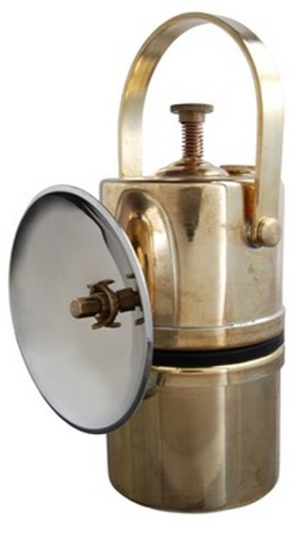 """Safe, simple and durable design of solid brass.     Water in the top chamber drips onto carbide fuel in the lower chamber which produces acetylene gas. A small amount of pressure builds up to push gas through the orifice in the 4-1/4""""OD chrome reflector.     Brightness is controlled with a valve that regulates how fast the water drips from upper to lower chamber.     Light with flint striker on reflector."""