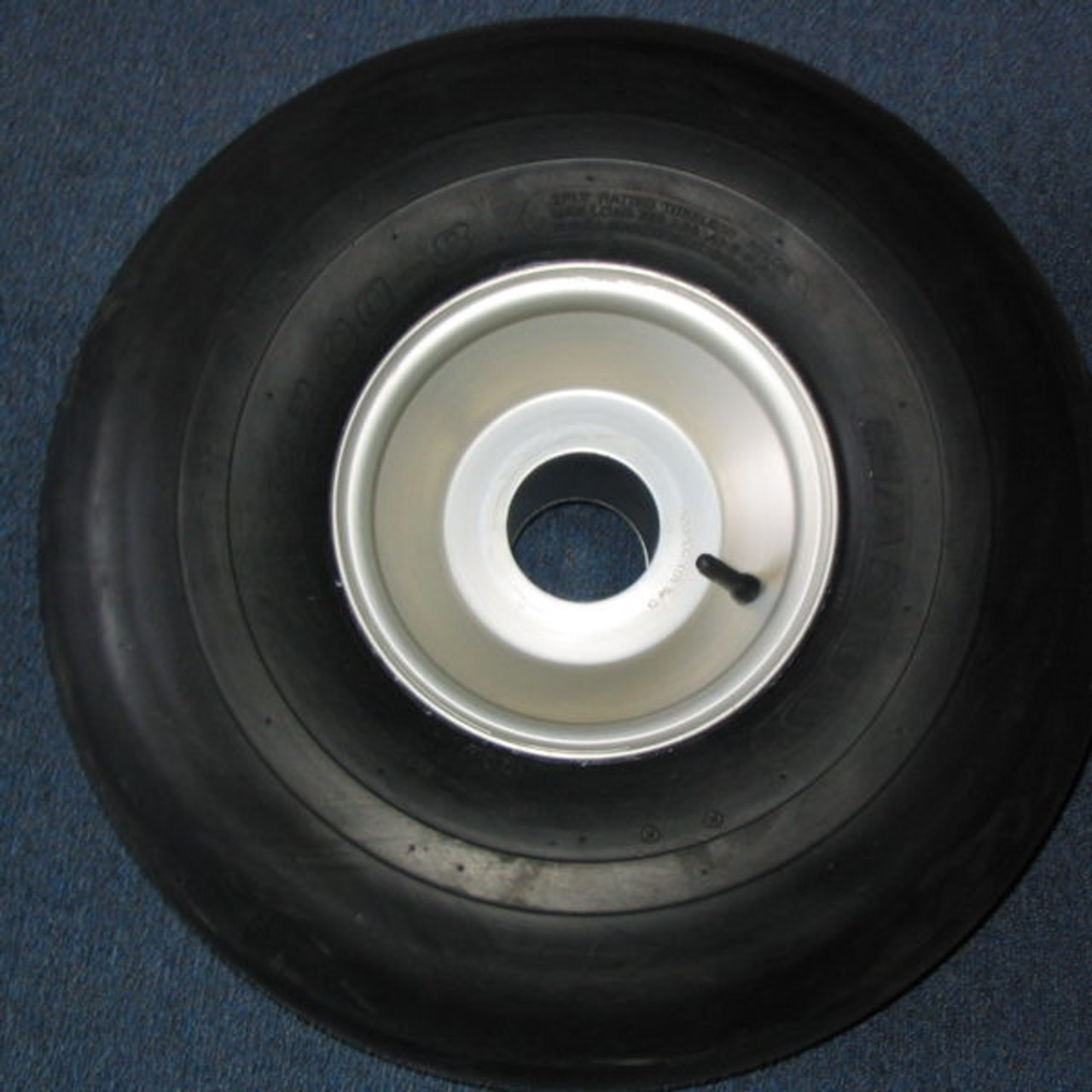 Tire and rim assembly for Cat Trax