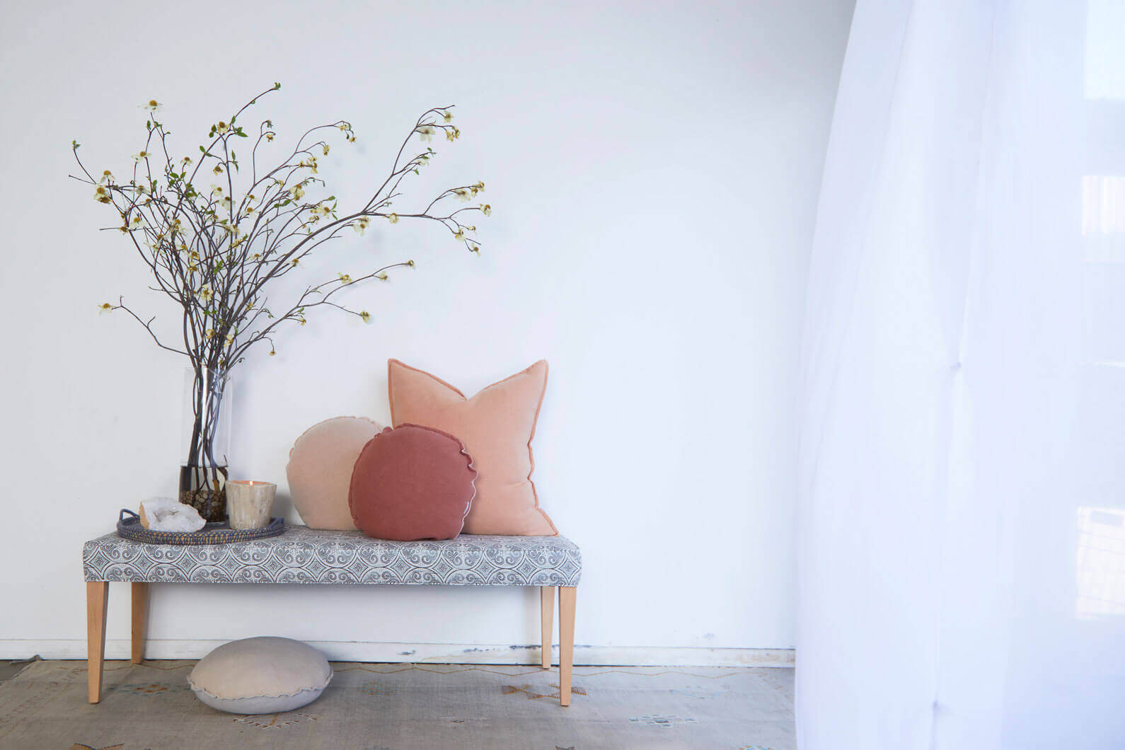 Upholstered bench with throw pillows
