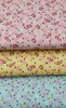 A lovely fresh floral 100% cotton poplin, Available in three colours,  Pink Green or yellow, Ideal for dresses, children's sleepwear and more 145 cm wide, Wash at 30 degrees, Comes with the OEKO-TEX standard 100 , making it suitable for children's sleepwear, Priced per metre