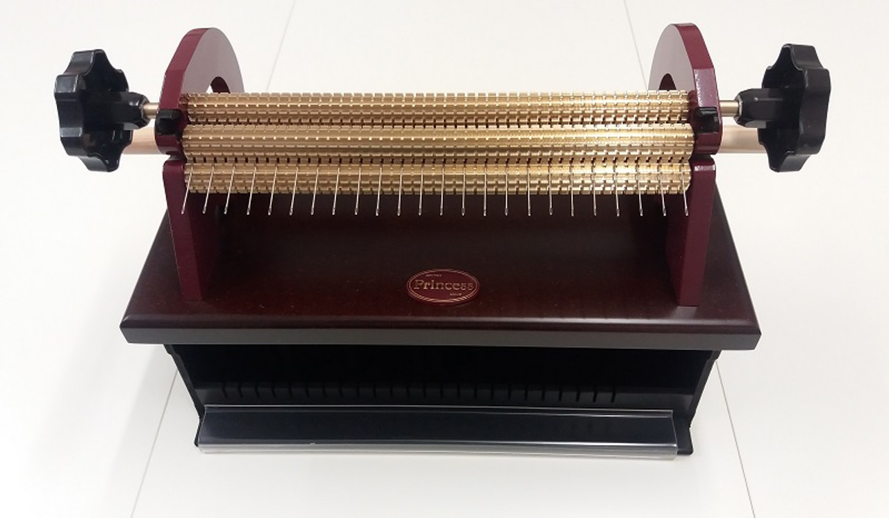 With its specially designed base it is an ideal companion for the Pleater Feeder  Most suited for the home smocker with 24 full space rows and half spaces for the full length of the rod.  Use for pleating fabric for Dresses, Puffing, Trims and so much more.  Pleat up all your Christmas ornaments, cushions and hangers in minutes.  Main difference between the Princess and the Read Maxi is that the Read Maxi has quick release pins to remove the roller for changing the needles.  The Princess Smocking Pleater has two locking nuts that you turn with the wooden dowel supplied.  I have been using this machine for quite some time and love the smooth action of the rollers.  If you have larger hands then there is also more space under the needles on the Princess than the Read Maxi.  Also available as a starter pack, See attached video shown using with the Feeder box . Included with this pleater.  Doweling to roll your fabric onto Wooden peg to turn the locking nuts Instruction leaflet, Fabric to run through the machine to absorb the oil used in transport, Spare needles,