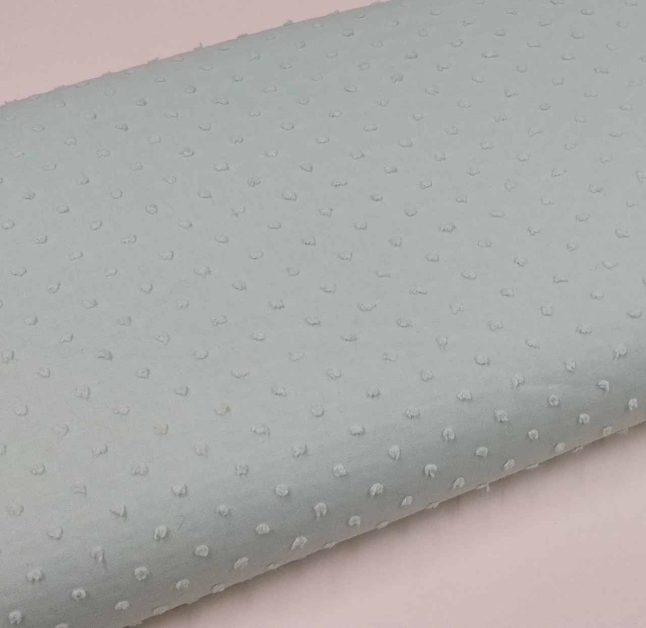 A lovely soft 100% cotton fabric with a cut spot, Colour - Seafoam 137 cm wide, Has the OEKO-TEX standard 100 - this makes it suitable for children's clothing and sleepwear, Choose seafoam piping to match, Wash at 30 degrees, Priced per metre