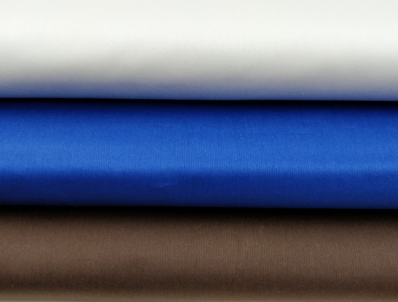 100% cotton pique in light blue, royal blue and brown, ideal for dresses, coats, boy's pants and baby bedding, 145 cm wide, wash at 30 degrees, priced per metre