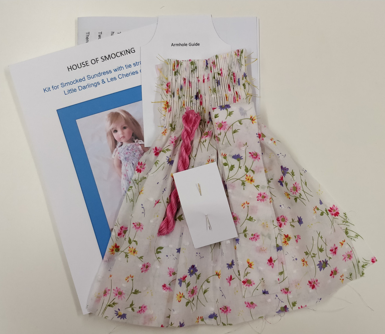 This is a kit for a sundress, smocked front and back with, tie shoulder straps Contents include,  Step by step instructions, Two smocking designs, Pre-pleated fabric for front and back, 2 x bias strips for straps, DMC thread, 1 x crewel needle Armhole cutting guide, Available in 5 colours,