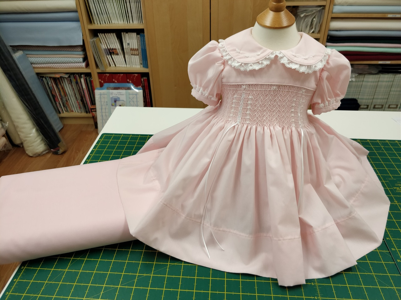 Pink imperial batiste made up using the Chery Williams Baby square yoke pattern and the Myles smocking plate by Ellen McCarn