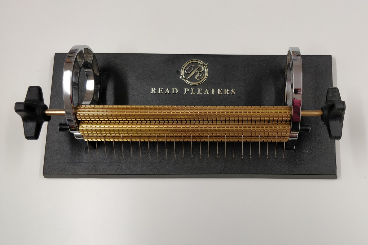 Current Model Read Pleater, Read 24 row Maxi Pleater has half cm spacing across the entire width of the roller (47 needles).   Half spaces can be used as guide lines when smocking and to improve holding difficult fabrics which tend to bubble. The Maxi can also be used as a Regular pleater (24 needles) by removing the half space needles (every second needle). This pleater has the following specifications Heavy duty stable base-plate with anti-skid rubber feet Extra large side-plate opening allowing for large capacity of rolled-up fabric Simple, pin-type roller holding system allows for quick and easy needle access Comfortable and user-friendly dual handles for maximum versatility Heavy-solid brass rollers Capable of handling heavy-weight fabrics Comes complete with Original Read Needles My personal opinion This is a great machine and will cope with most pleating tasks The two handles gives that extra grip with thicker fabric or if you are left handed Plus points - Very easy to remove the roller to change the needles, Full length half space rows so if you are smocking shoulder to waist or use silk fabrics or prefer more guide rows, then this is the machine for you Minus points - non really just a shame the base is that bit larger to sit directly on the Feeder box like the Princess Pleater Can be used with the Pleater Feeder using the adapter lid Adapter lid supplied free when buying a pleater and feeder