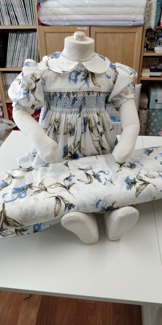 Cream and cornflower blue corsage 100% cotton with cut spot 147 cm wide - take care if using iron on dots due to the uneven surface - priced per metre - DMC 341 is a good match for this fabric