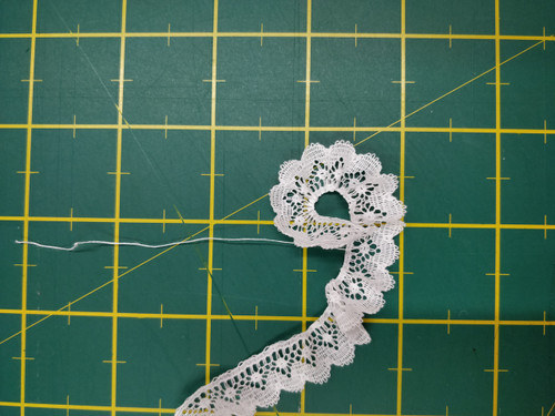 Spot and fan design edging lace 1.3 cm wide (HOS 7) - shown here gathered using the thread in the lace