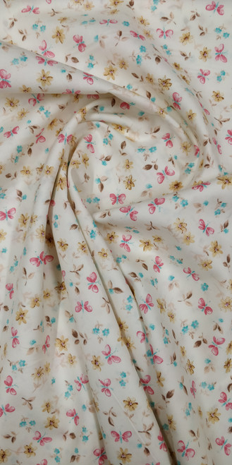 "A lovely quality cotton print, Ivory background with butterfly design,  100% cotton, 45"" or 110 cm wide, Ideal for sewing and smocking projects,  Wash at 30 degrees, Priced per metre"
