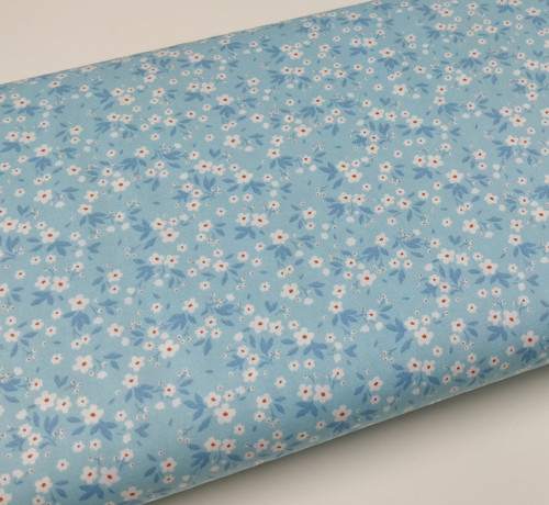 A really pretty blue floral fabric, 100% cotton poplin, Ideal for dresses, skirts, blouses and more, 112 cm wide, Thread and piping suggestions shown Priced per metre Wash at 30 degrees