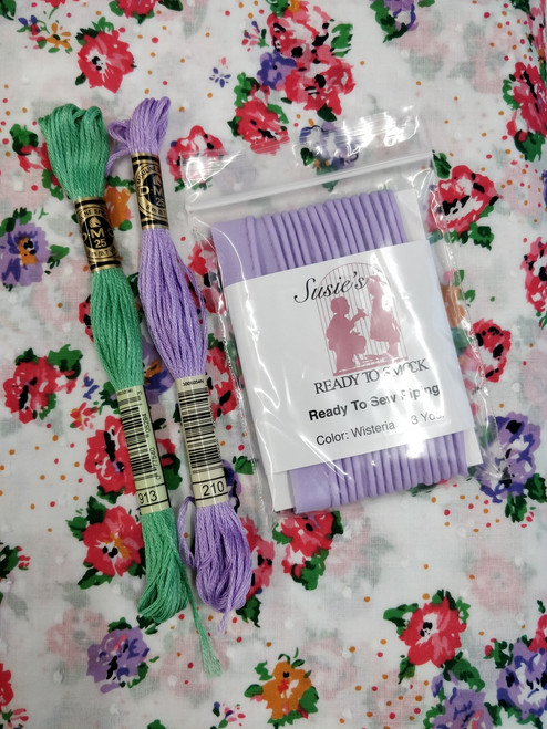 Cut spot fabric shown with wisteria piping and DMC threads