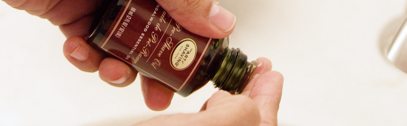 The Art of Shaving pre-shave oil being applied to fingertips.