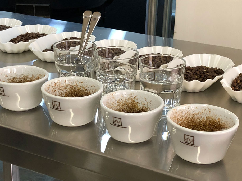 Cupping fresh crop at Bunni. We cup to test quality at all levels - as green beans and roasted beans. High quality is key. Get in touch to arrange a cupping session or event.