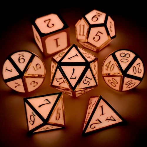 Metal dnd dice set glow in the dark gold glowing pink