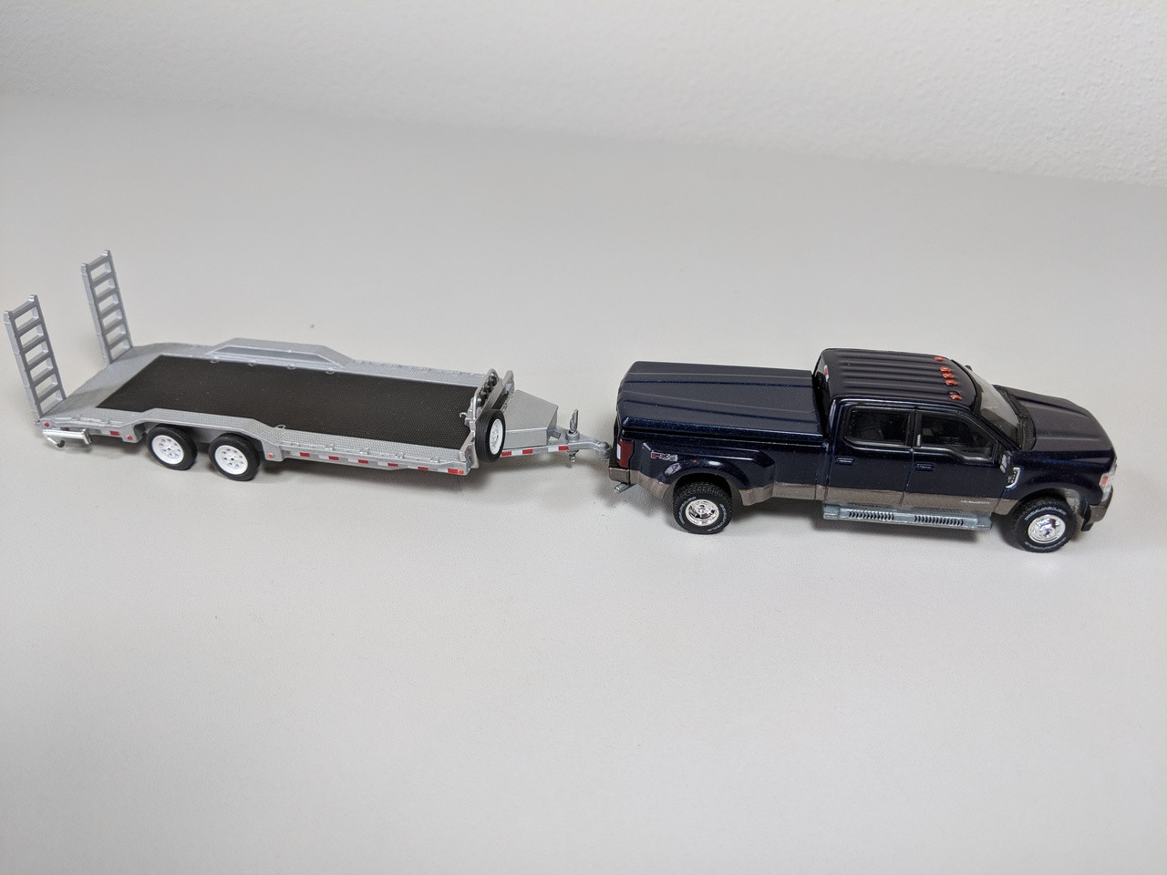 1 64 Hitch Tow 2018 Ford F 350 King Ranch Dually Blue Jeans Upper With Stone Gray Lower Accent And Hd Flat Bed Trailer Town And Country Toys