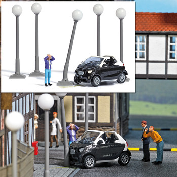 1:87 Busch # 7821 Smart Car Crash with Damaged Car, Driver, Five Lamp Posts