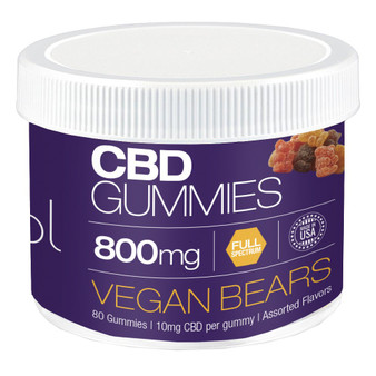 Round plastic tub filled with many flavors of gummy bears with CBD.