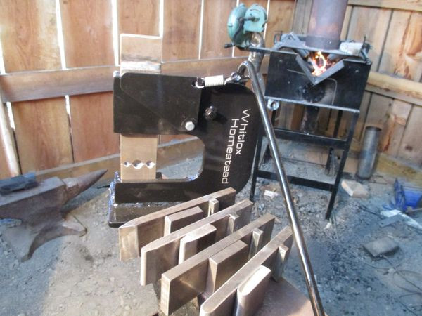 Blacksmith helper tool with 7 dies is powered by your hammer, not electricity or hydraulics