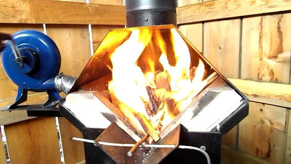 A forge hood reflects heat for a hotter fire with less fuel consumption.