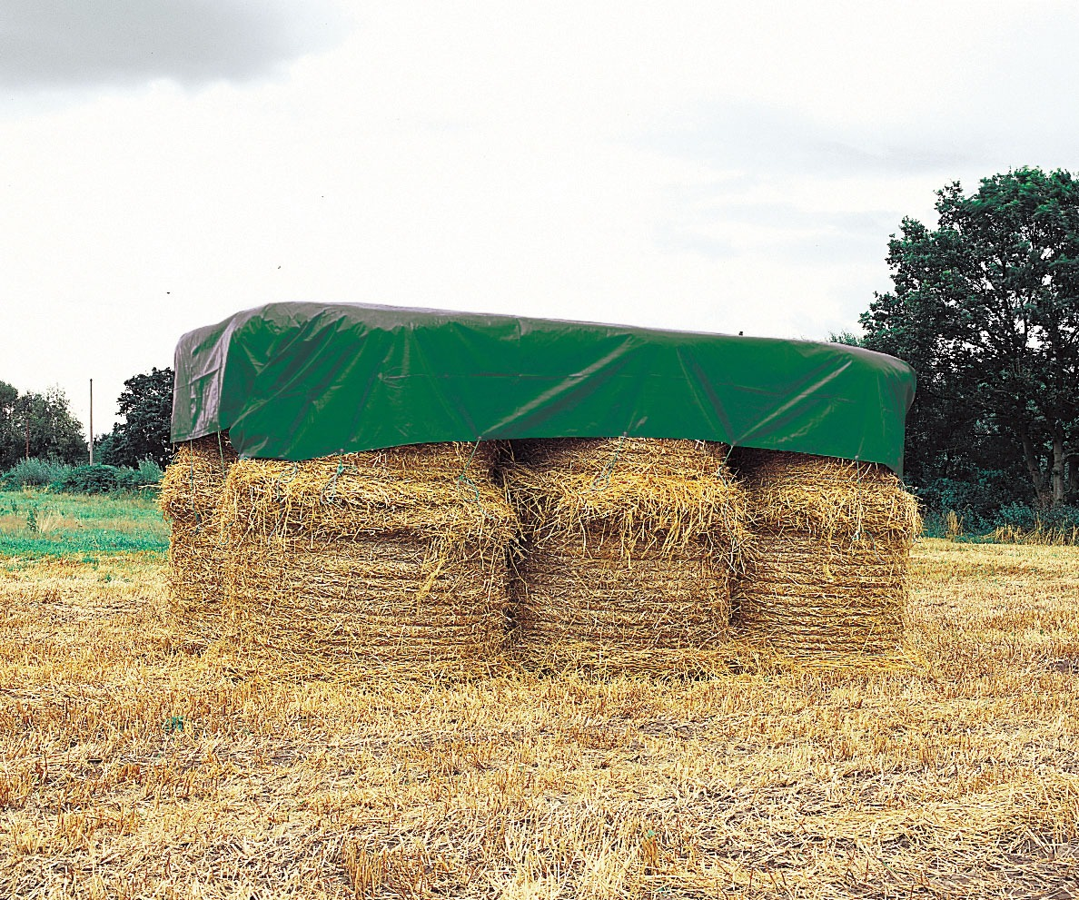 Huge Hay Bails in Field Covered by Tarp