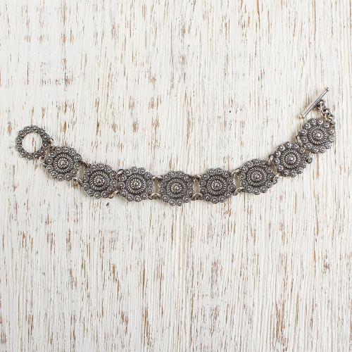 Sterling silver flower bracelet 'Spinning Daisies'