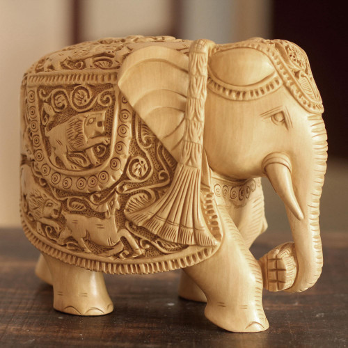 Wood sculpture 'Elephant Goes Hunting'