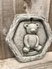 A limestone, stone garden plaque.