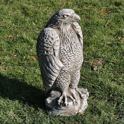 A stone eagle statue, a garden ornament.