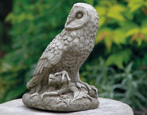 A stone owl statue, a garden ornament.