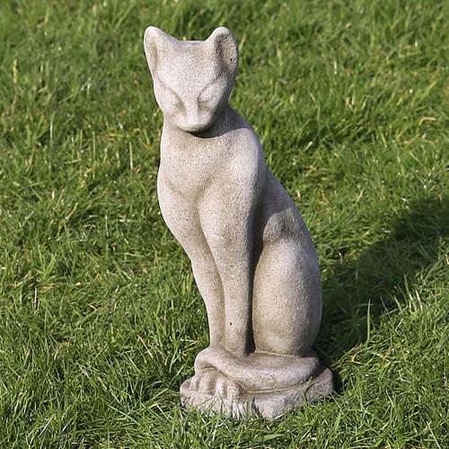 A stone Siamese cat statue, a garden ornament.